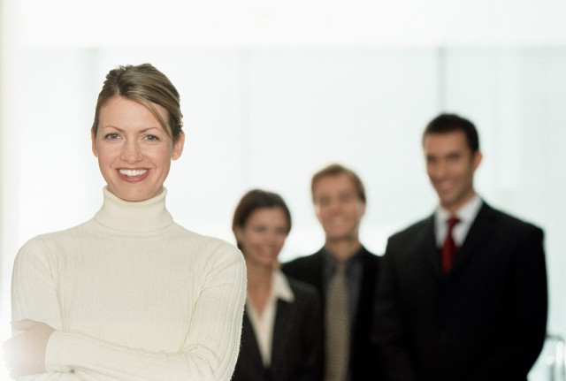 Cheerful Businesswoman with Colleagues